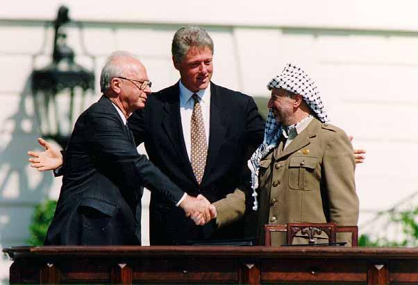 Yasser Arafat and Yitzhak Rabin shake hands at the White House, 1993