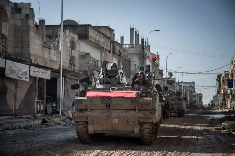 Turkish troops entering Syria. AFP Photo/Mursel Coban